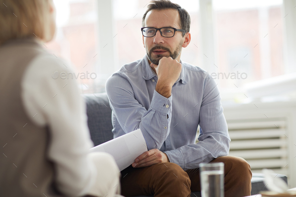 Talking on couch - Stock Photo - Images