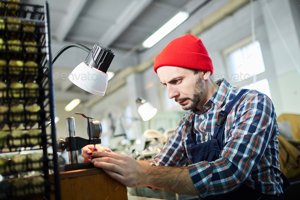 Watchmaker Working at Factory - Stock Photo - Images