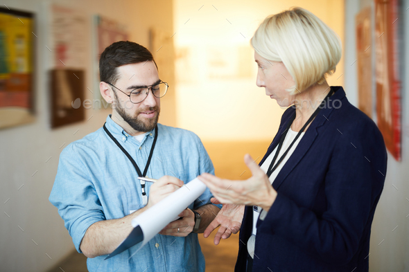 Two Workers in Art Gallery - Stock Photo - Images