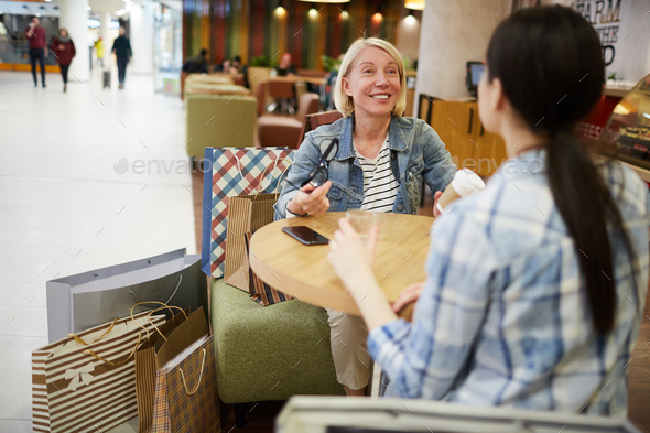 Jolly mature woman sharing emotions from shopping - Stock Photo - Images
