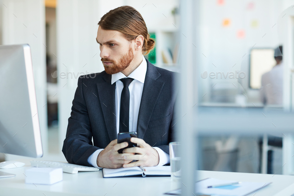 Businessman in front of computer - Stock Photo - Images