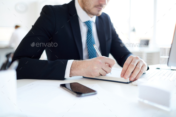 Making notes by workplace - Stock Photo - Images