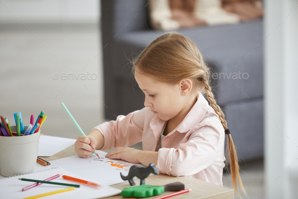 Little Girl Drawing Animals - Stock Photo - Images