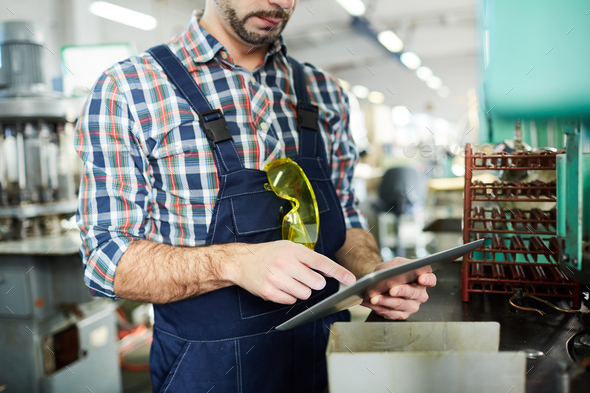 Unrecognizable Factory Worker Using Tablet - Stock Photo - Images