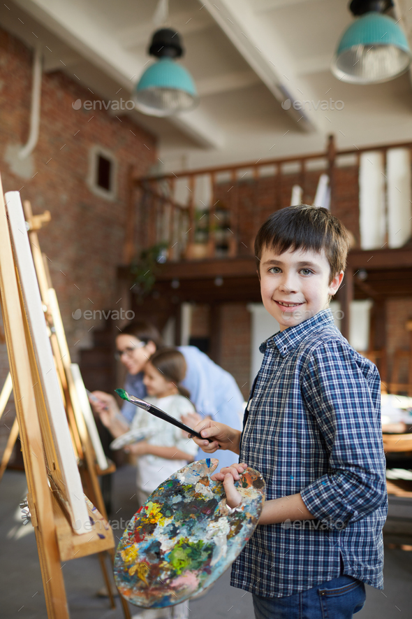 Cute Boy Painting at Easel - Stock Photo - Images