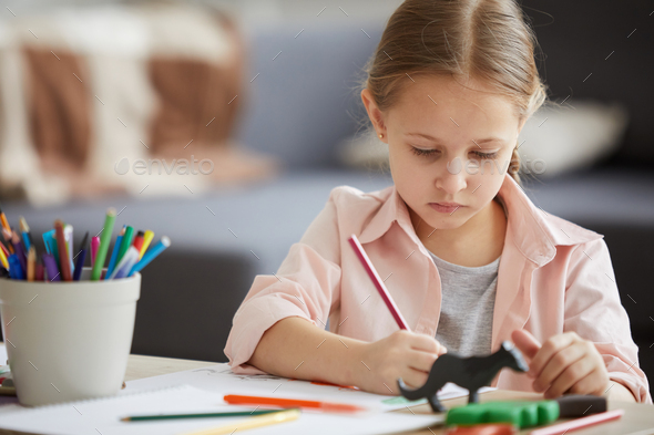 Little Girl Drawing with Crayons - Stock Photo - Images