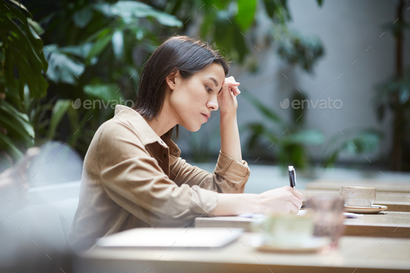 Busy student solving task in cafe - Stock Photo - Images