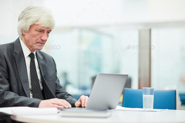 Senior Businessman Using Laptop - Stock Photo - Images