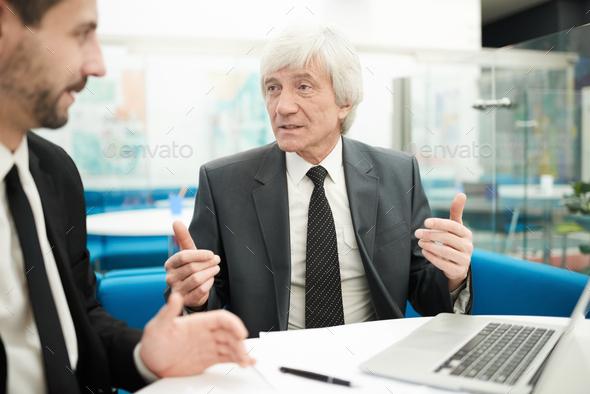 Senior Businessman in Meeting - Stock Photo - Images