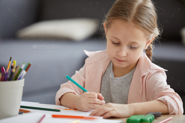 Diligent Little Girl Studying - Stock Photo - Images