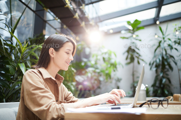 Web administrator answering messages - Stock Photo - Images