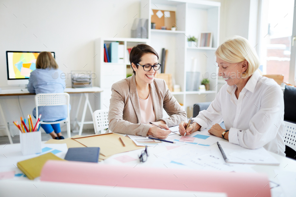 Businesswomen Discussing Project - Stock Photo - Images