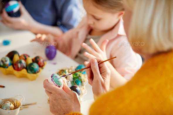 Woman Painting Easter Eggs - Stock Photo - Images