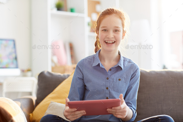 Happy Teenage Girl Holding Tablet - Stock Photo - Images