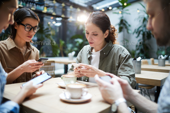 Gadget-addicted startuppers solving problem - Stock Photo - Images