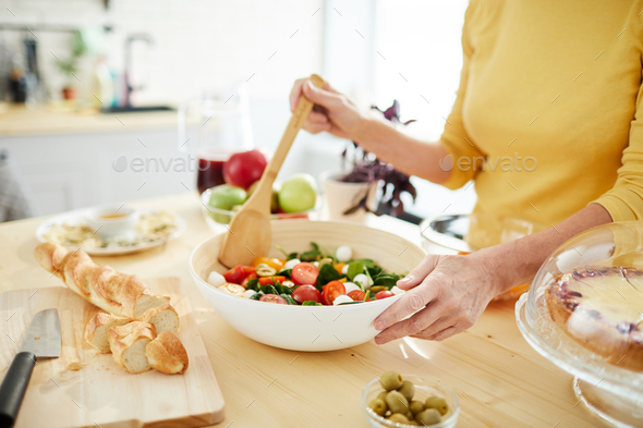 Housewife making salad for dinner - Stock Photo - Images