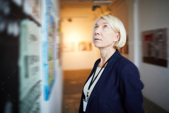 Mature Woman in Art Gallery - Stock Photo - Images