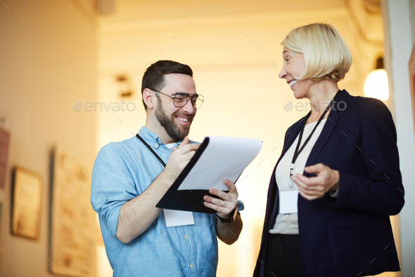 Cheerful Art Gallery Workers - Stock Photo - Images
