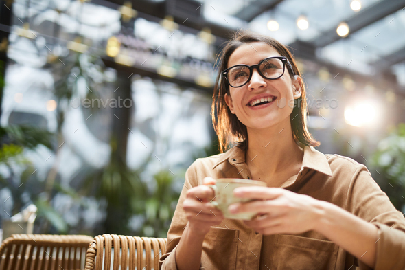 Cheerful lady drinking coffee - Stock Photo - Images