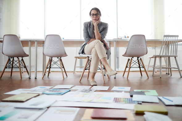 Businesswoman Planning Project in Empty Office - Stock Photo - Images