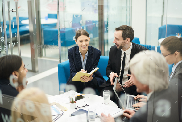 Cheerful Businesswoman in Meeting - Stock Photo - Images