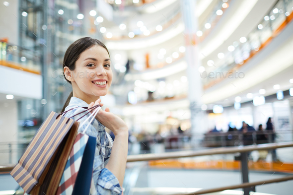 Positive girl with purchases - Stock Photo - Images