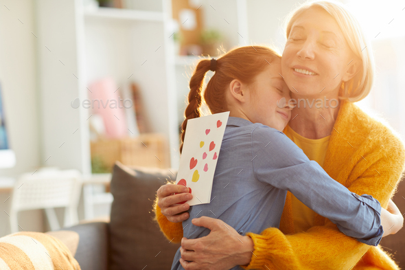 Mother and Daughter Hugging - Stock Photo - Images
