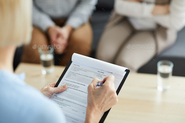 Putting ticks in document - Stock Photo - Images