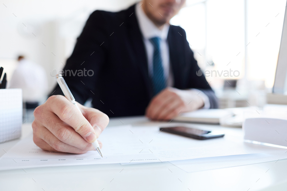 Pointing at paper - Stock Photo - Images