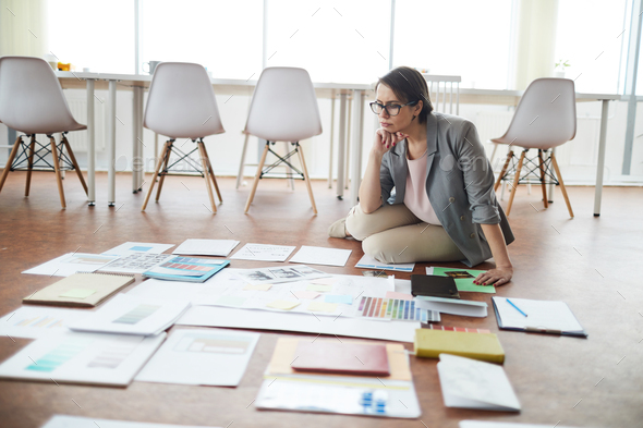 Businesswoman Planning Project on Floor - Stock Photo - Images
