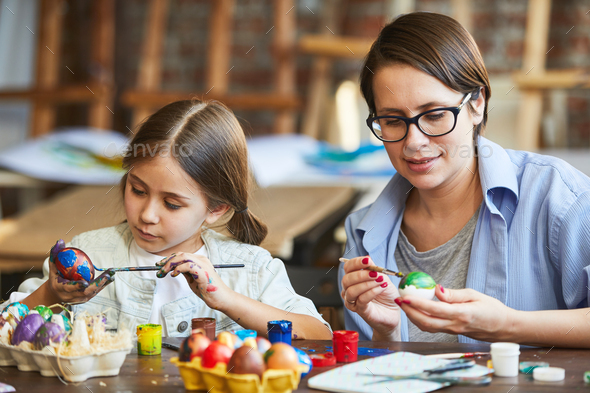 Mother and Daughter Painting Easter Eggs - Stock Photo - Images