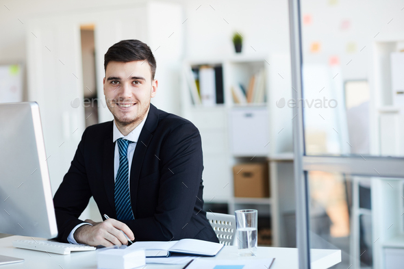 Businessman by desk - Stock Photo - Images