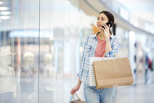 Sharing information about shopping with friend on phone - Stock Photo - Images