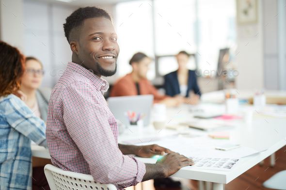 Young African Man Posing in Office - Stock Photo - Images