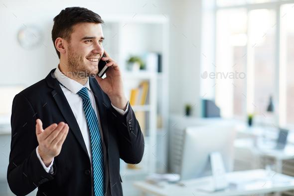 Explaining on the phone - Stock Photo - Images
