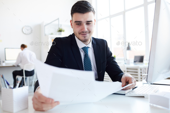 Young banker at work - Stock Photo - Images