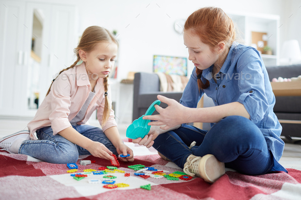 Two Sisters Playing Together - Stock Photo - Images