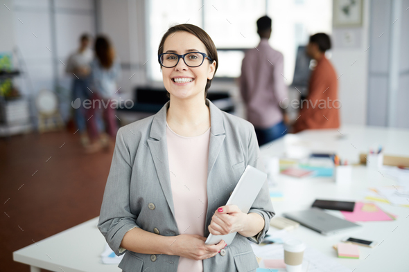 Smiling  Businesswoman Posing in Office - Stock Photo - Images