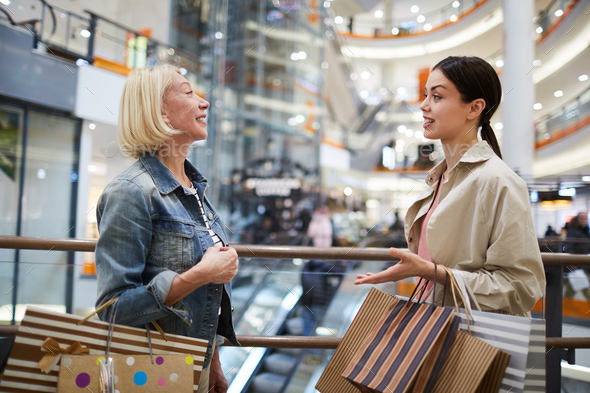 Buying clothing with shopping assistant - Stock Photo - Images