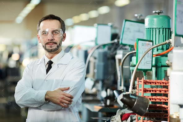 Mature Factory Worker Wearing Lab Coat - Stock Photo - Images