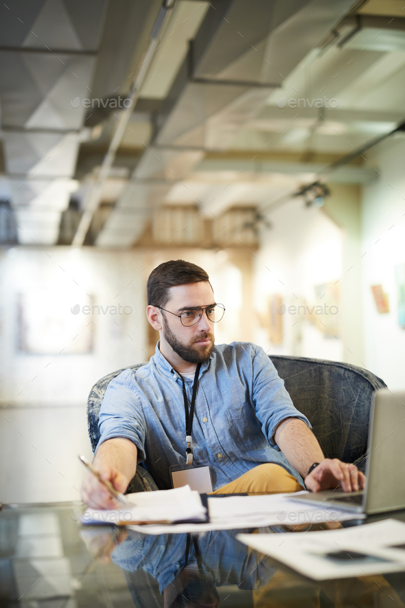 Businessman Working in Art Space - Stock Photo - Images