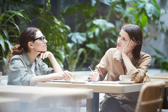 Introspective ladies thinking about strategies - Stock Photo - Images