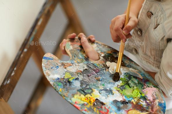 Little Girl Holding Palette - Stock Photo - Images