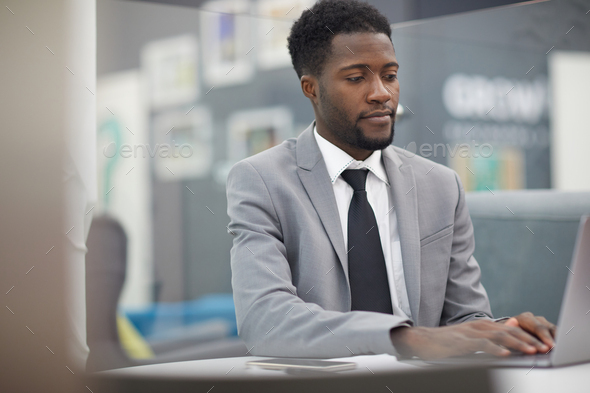 Successful African Businessman at Work - Stock Photo - Images