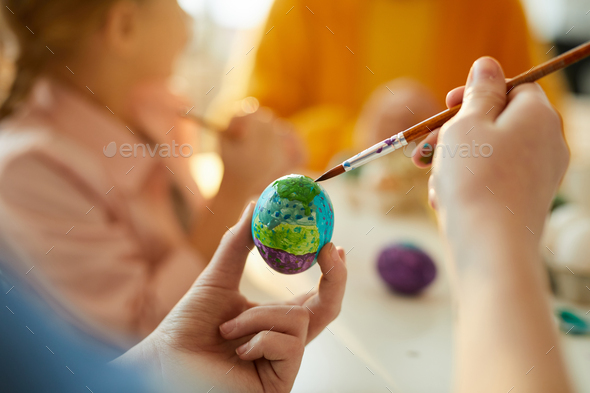 Unrecognizable Child Painting Easter Eggs - Stock Photo - Images