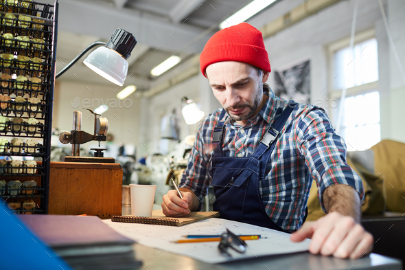 Worker  Drawing Plans at Factory - Stock Photo - Images