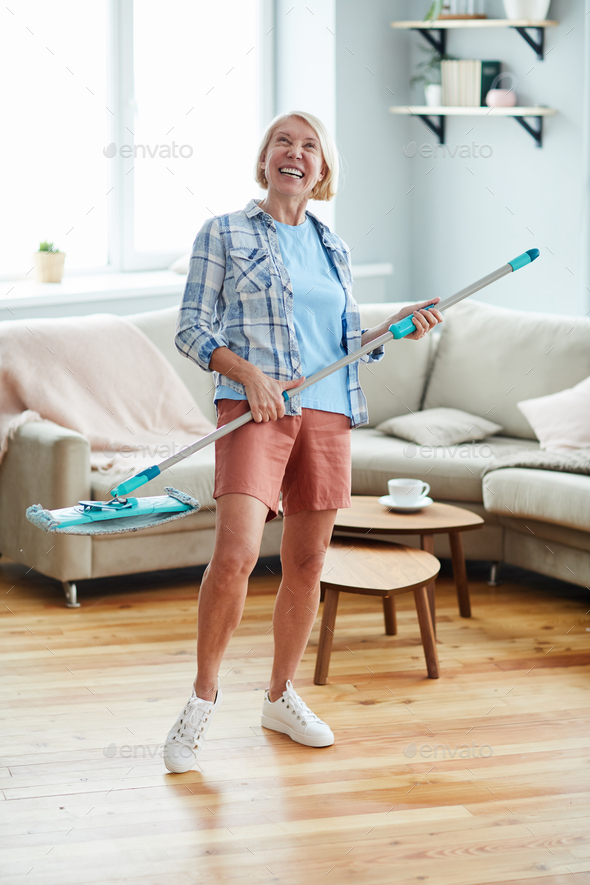 Excited woman enjoying housekeeping - Stock Photo - Images
