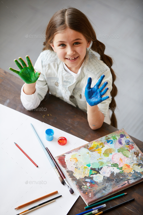 Cute Girl Enjoying painting - Stock Photo - Images
