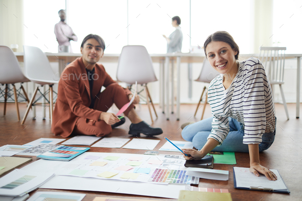 Two Designers Planning Project on Floor - Stock Photo - Images