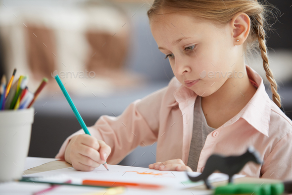 Cute Girl Drawing Animals - Stock Photo - Images